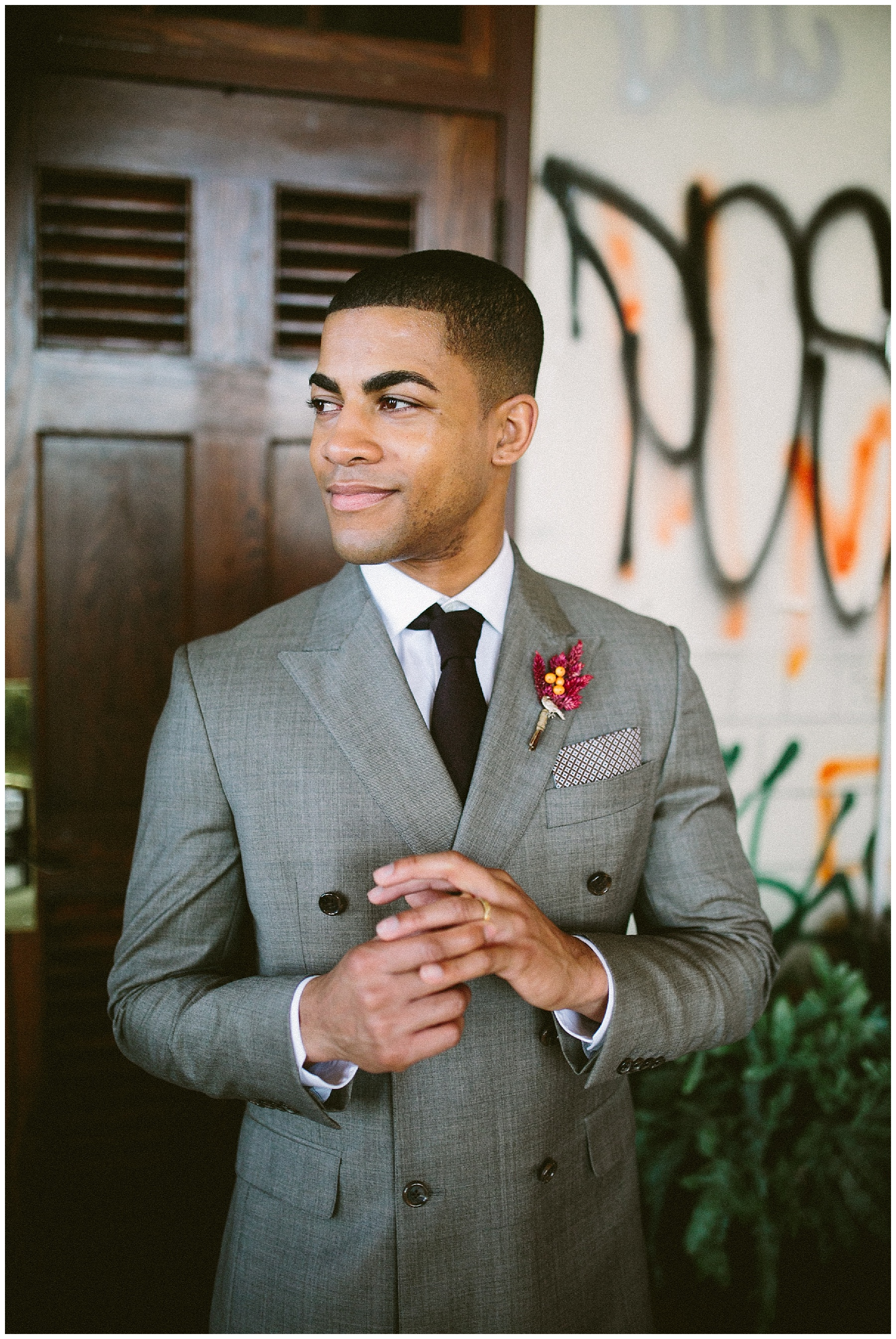 Grey suit and red boutonniere