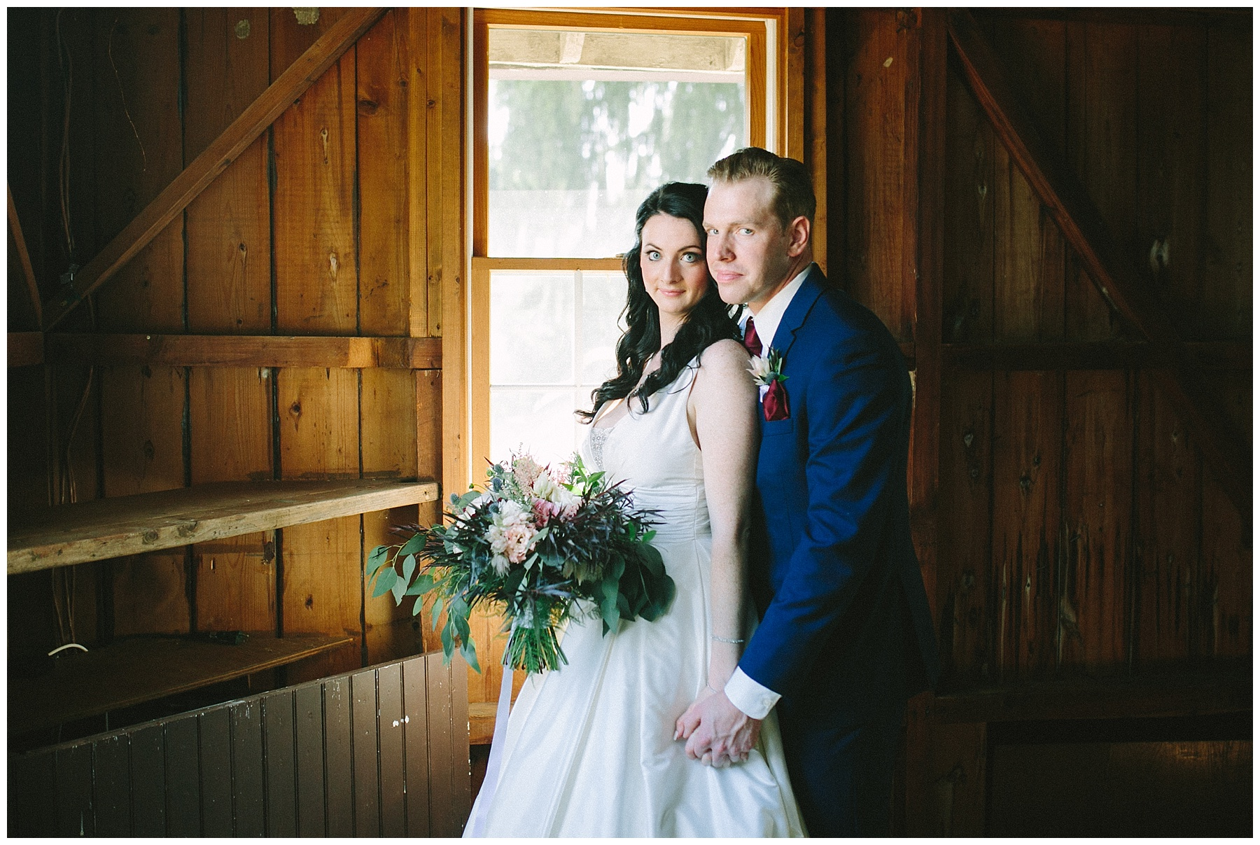 navy blue groom suit and bride